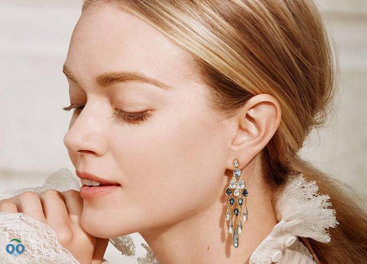 Wearing exquisite earrings that sparkle in the light with her every move