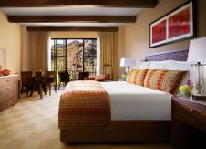 A Resort Room offers a king bed with luxurious linens, The Ritz-Carlton