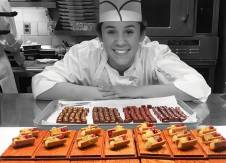 Estela proudly showcasing our exquisite Petits Fours and Chocolates, Daniel